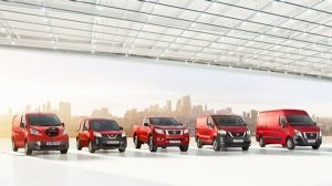 Nissan fleet cars in red with a skyscraper backdrop