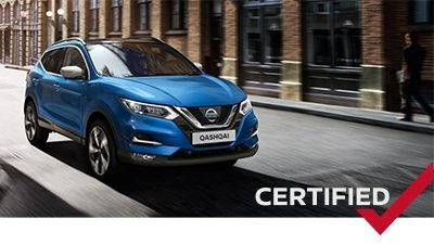 Blue Nissan Qashqai on the road in the city