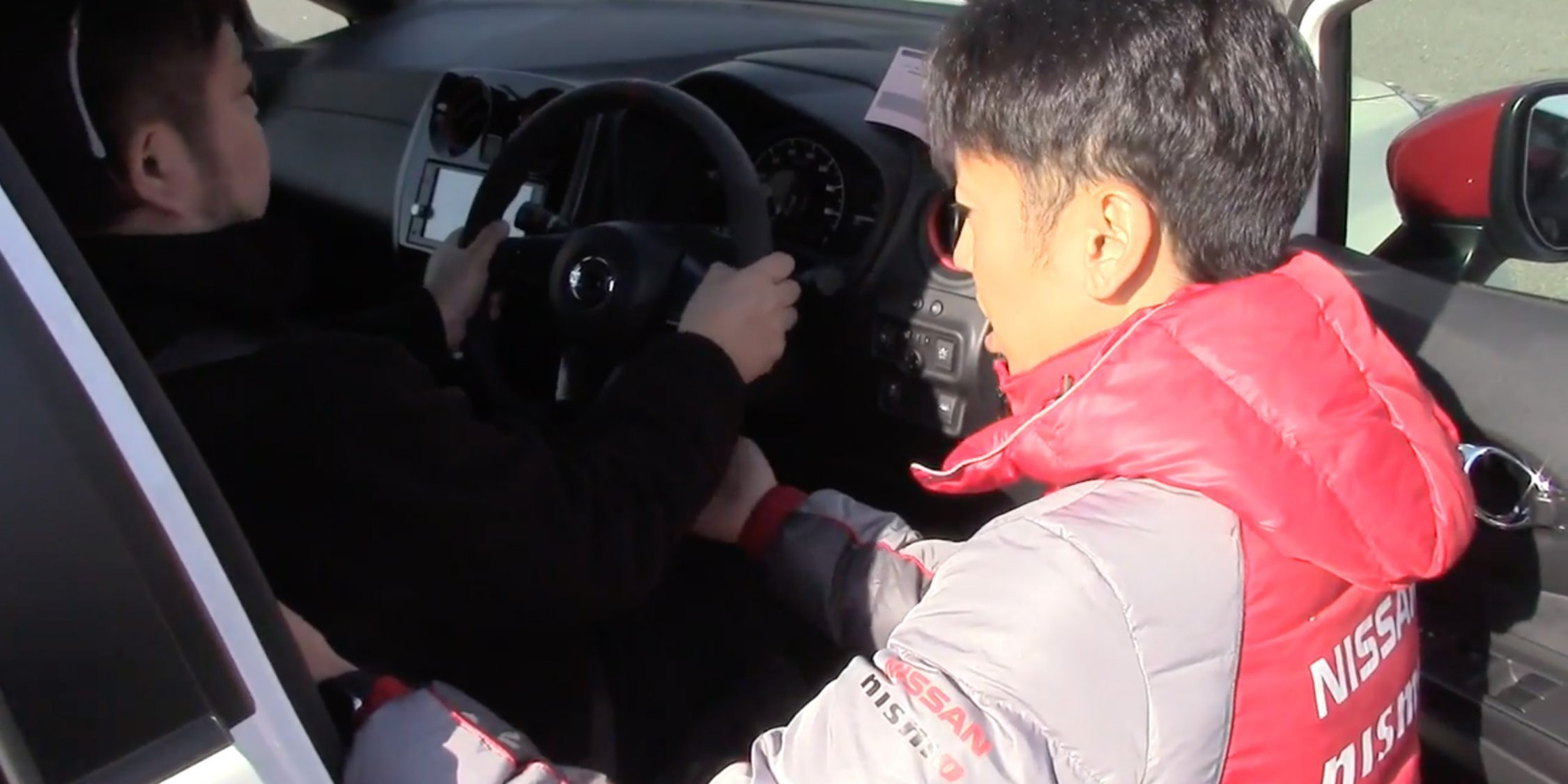 NISMO Driving Academy instructor with student