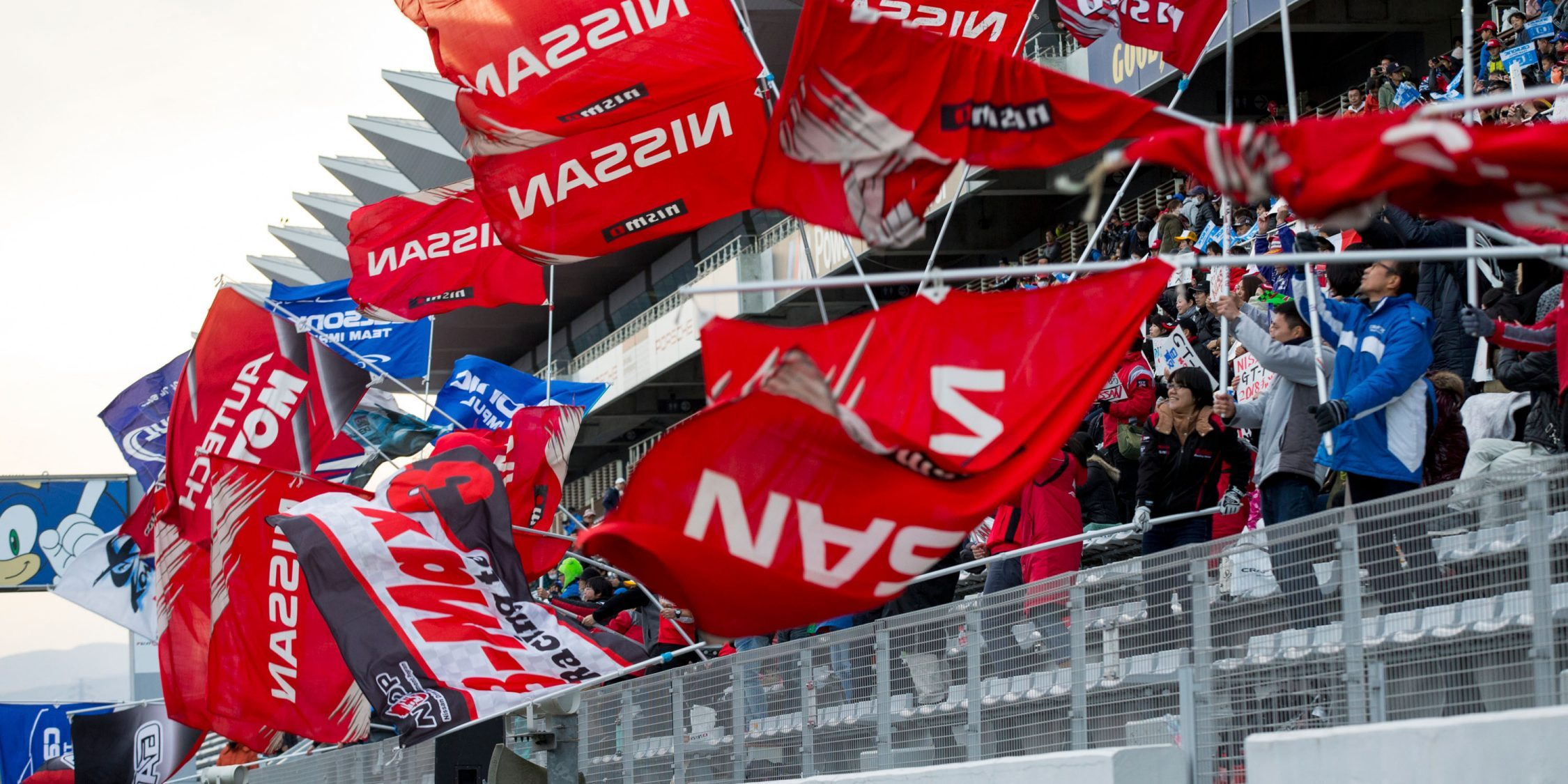 Nissan flags waving from the stands