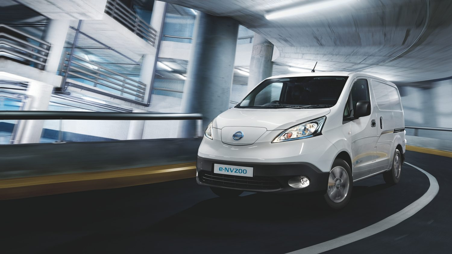 Nissan e-NV200 white - Front angle driving on curve