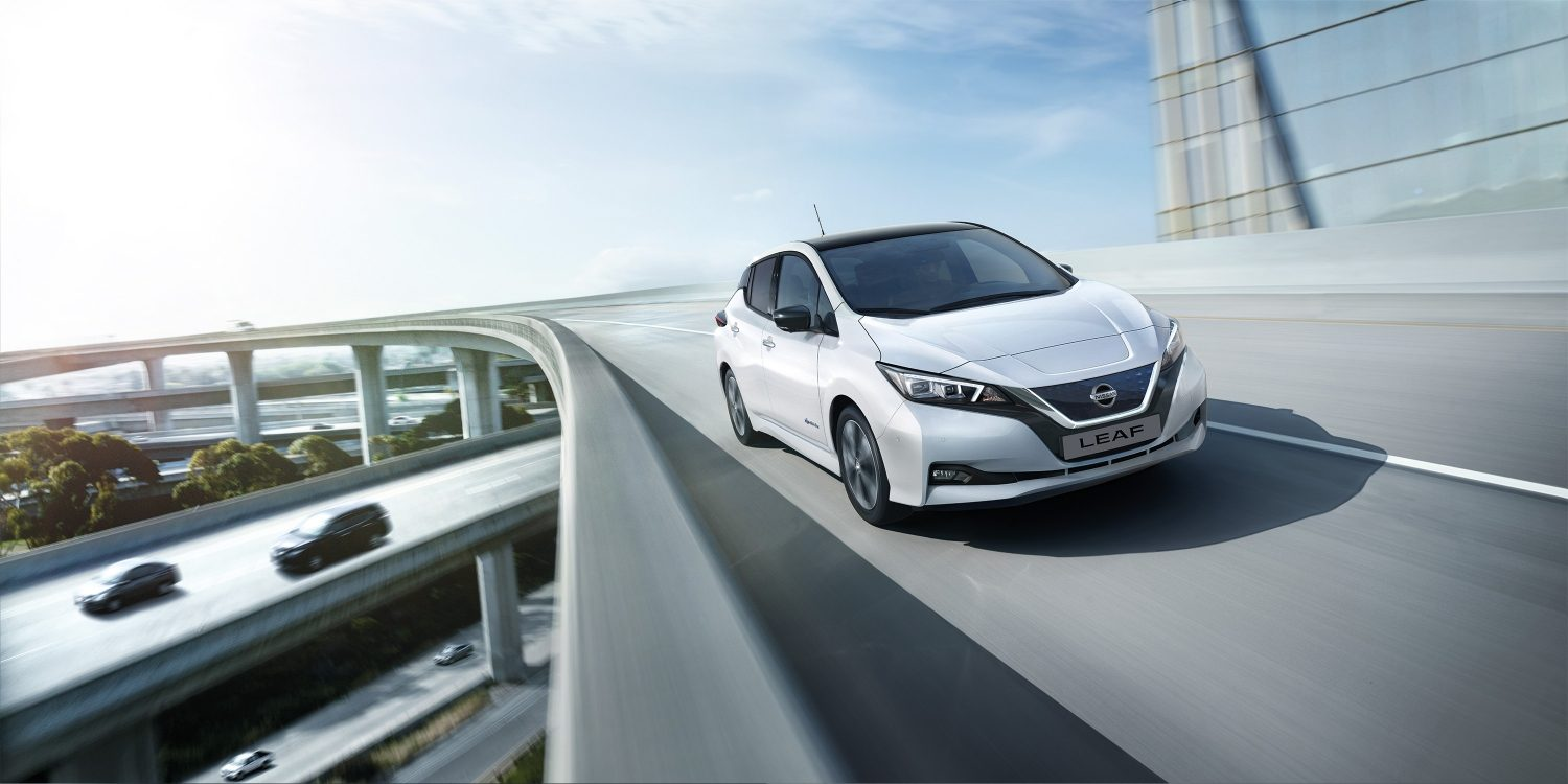 New Nissan LEAF driving on a highway with graphic of e-Pedal next to it