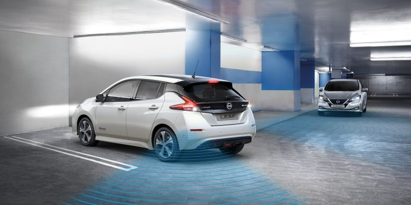 New Nissan LEAF in a garage showing Rear Cross Traffic Alert detecting a vehicle coming towards it