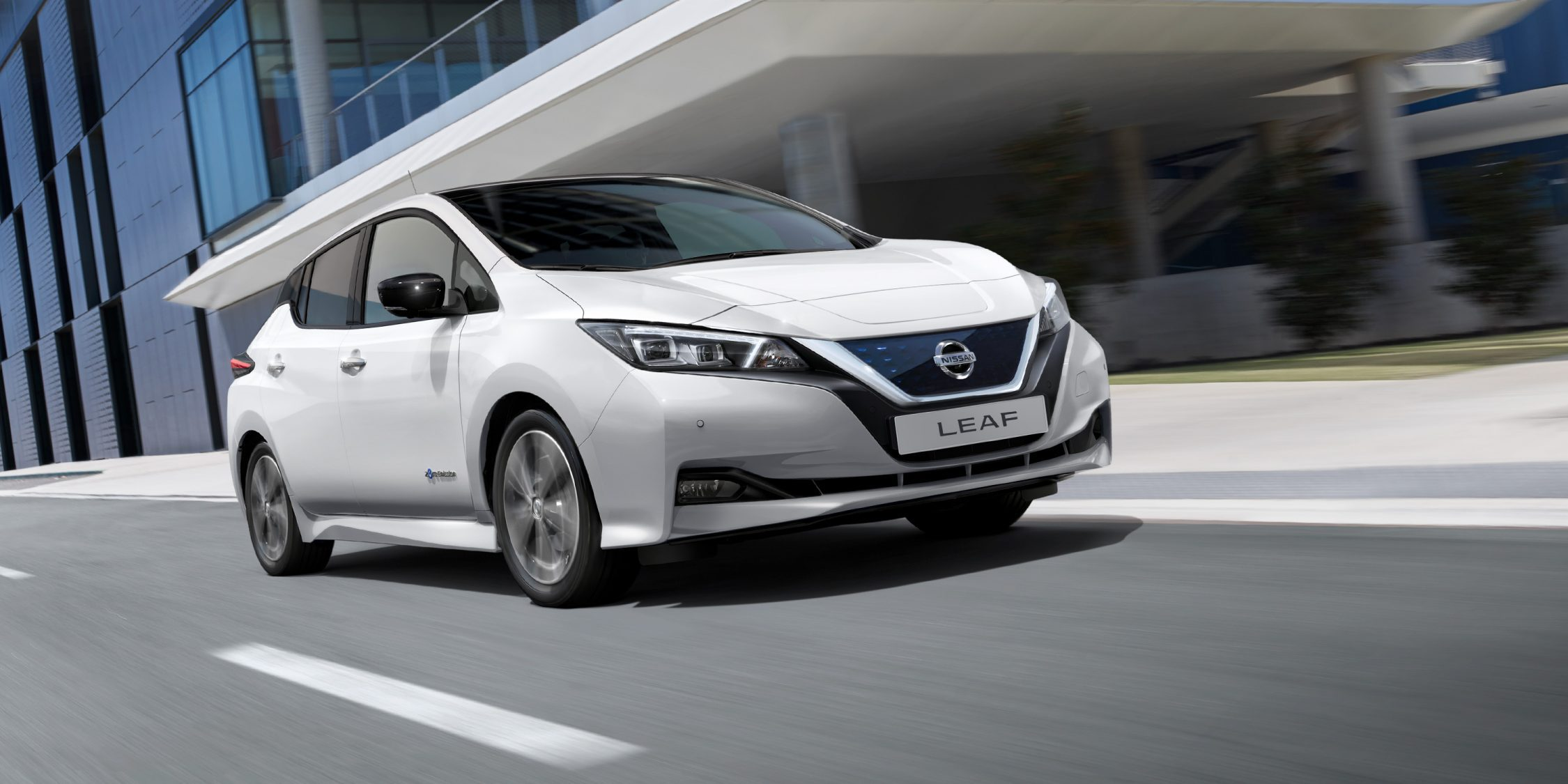 New Nissan LEAF driving on a city street