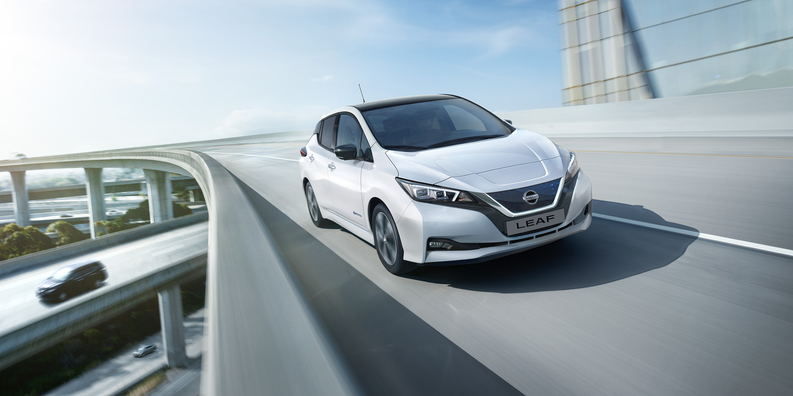 New Nissan LEAF driving on a bridge