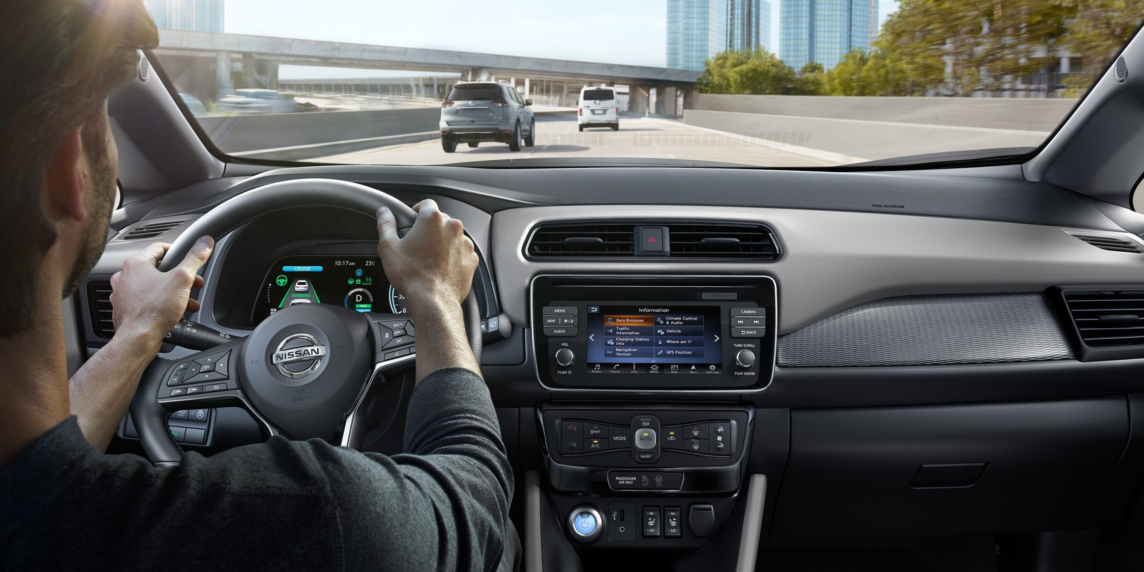 New Nissan LEAF interior showing person driving on a highway