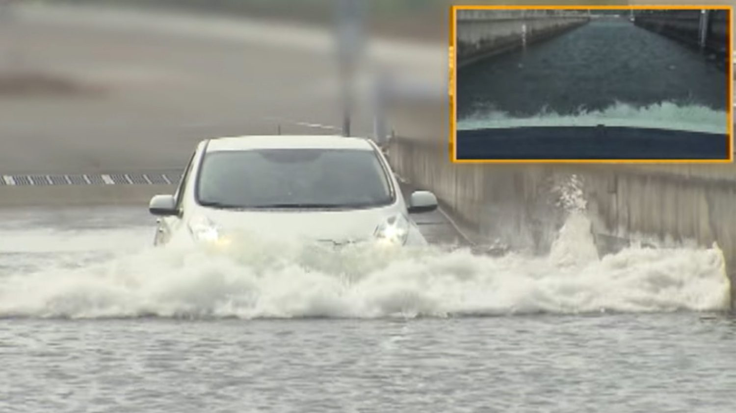 Nissan LEAF shown driving through water