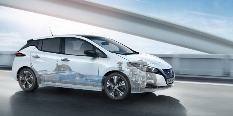New Nissan LEAF driving on a bridge with battery and motor showing