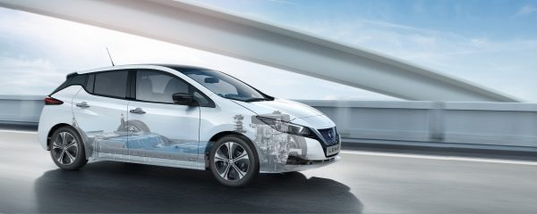 Nissan LEAF in city with driving sensor graphics