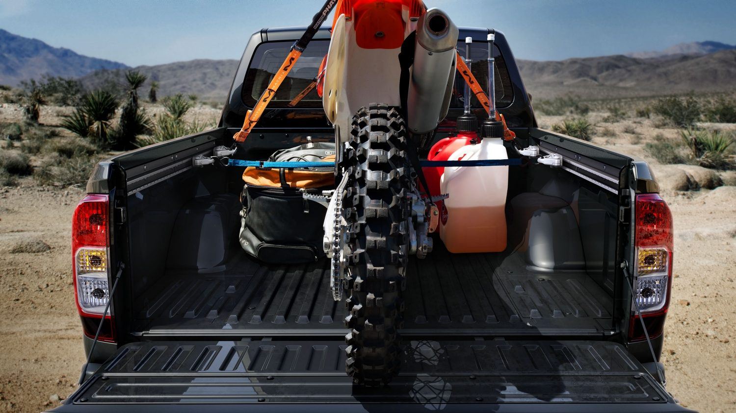 Rear Static Shot of Cargo Bed with Dirt Bike Loaded in Desert
