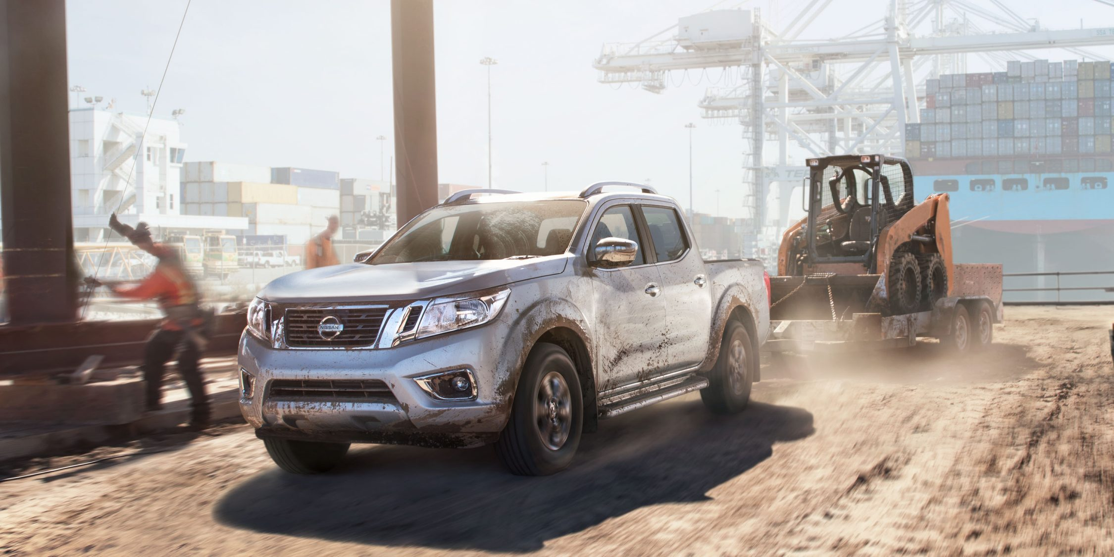 Nissan Navara hauling large equipment in port setting