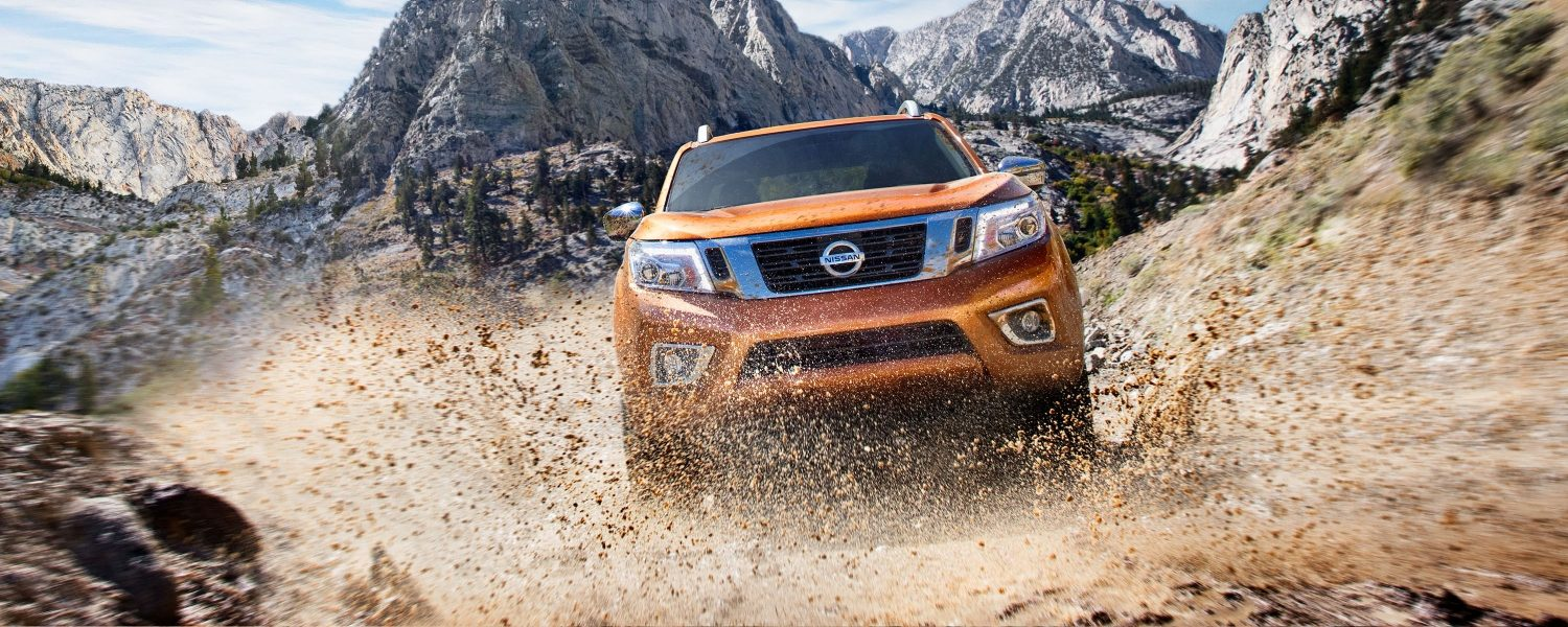 Nissan Navara driving off-road in the mountains