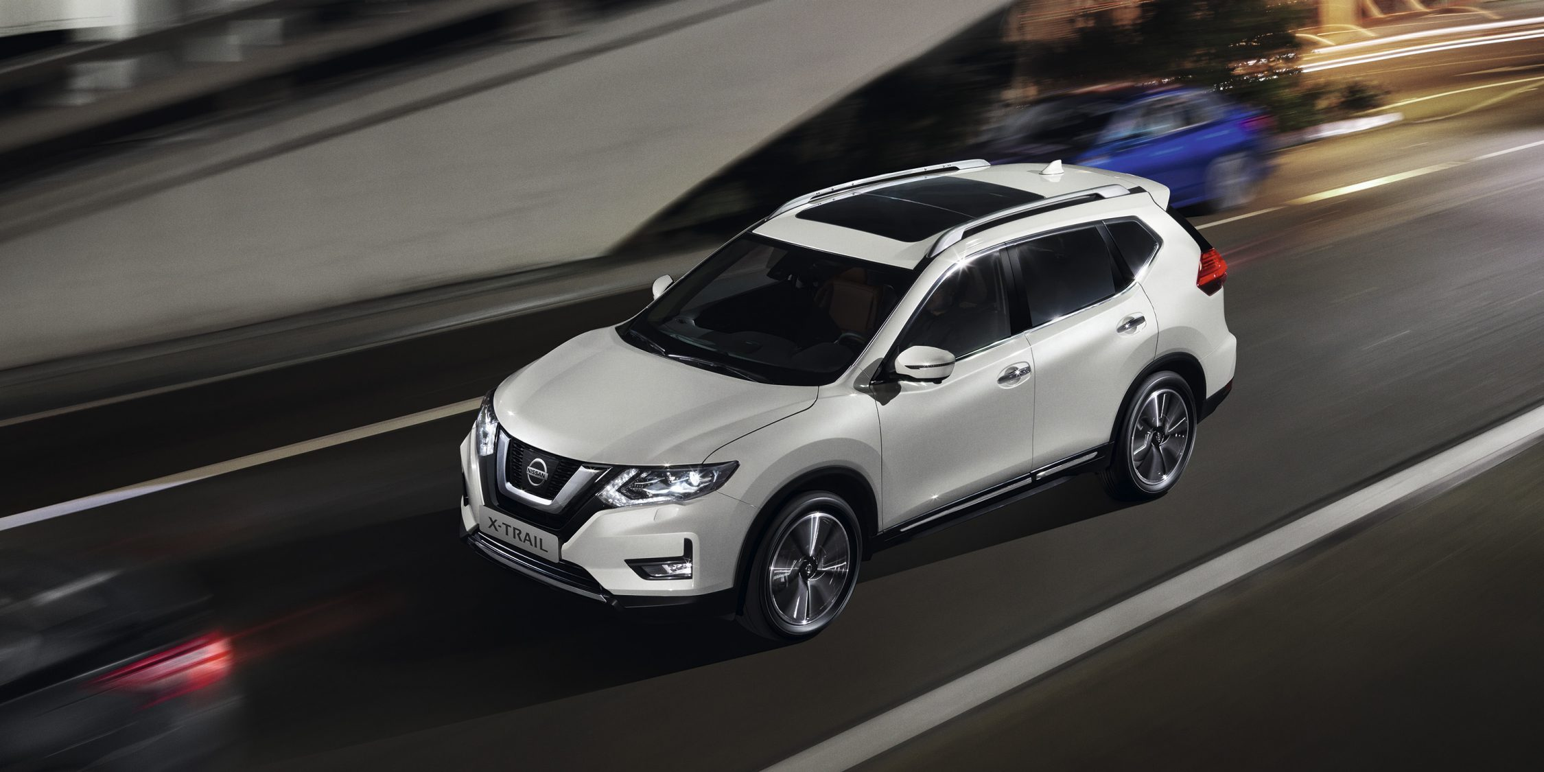 Nissan X-Trail driving on an urban road