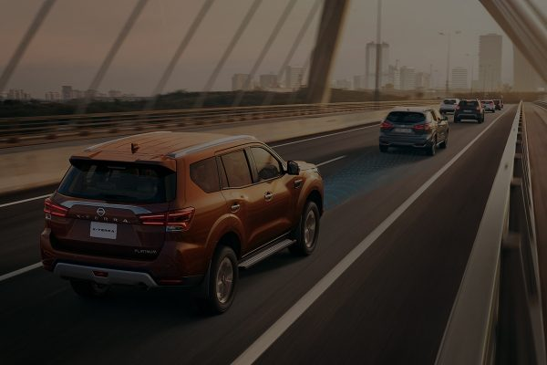 2021 Nissan X-Terra showcasing safety feature while driving over bridge