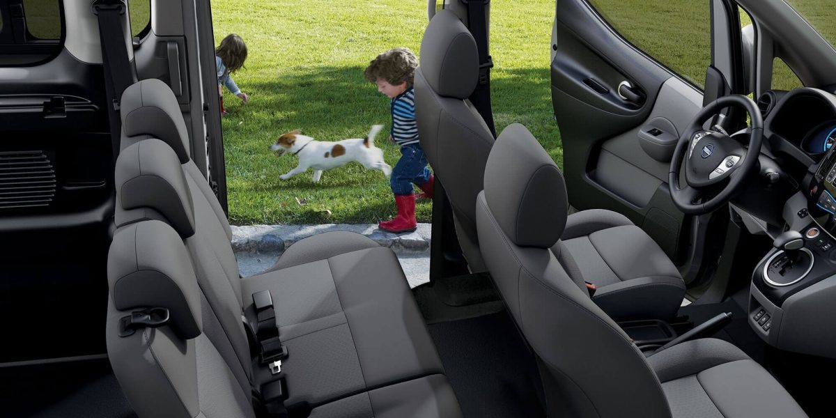 New Nissan e-NV200 Evalia interior view with children playing around the car