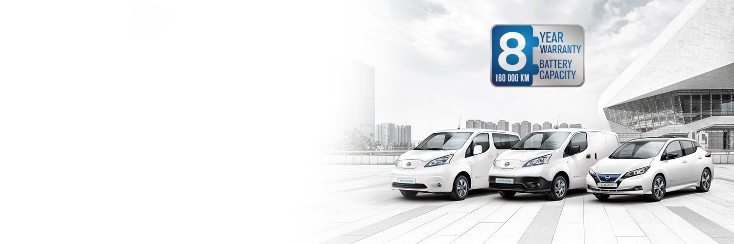 Nissan electric vehicles lined up with warranty badge