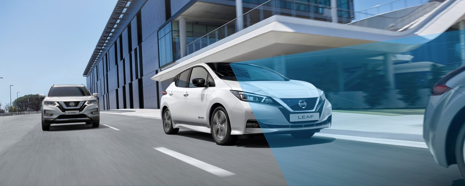 New Nissan Leaf driving in the streets with Nissan Intelligent Mobility waves