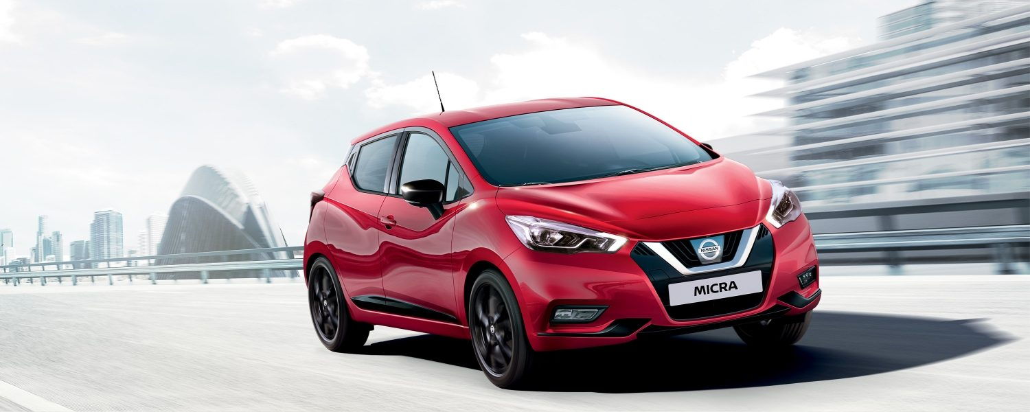 New Nissan Micra driving on a bridge 3/4 front view