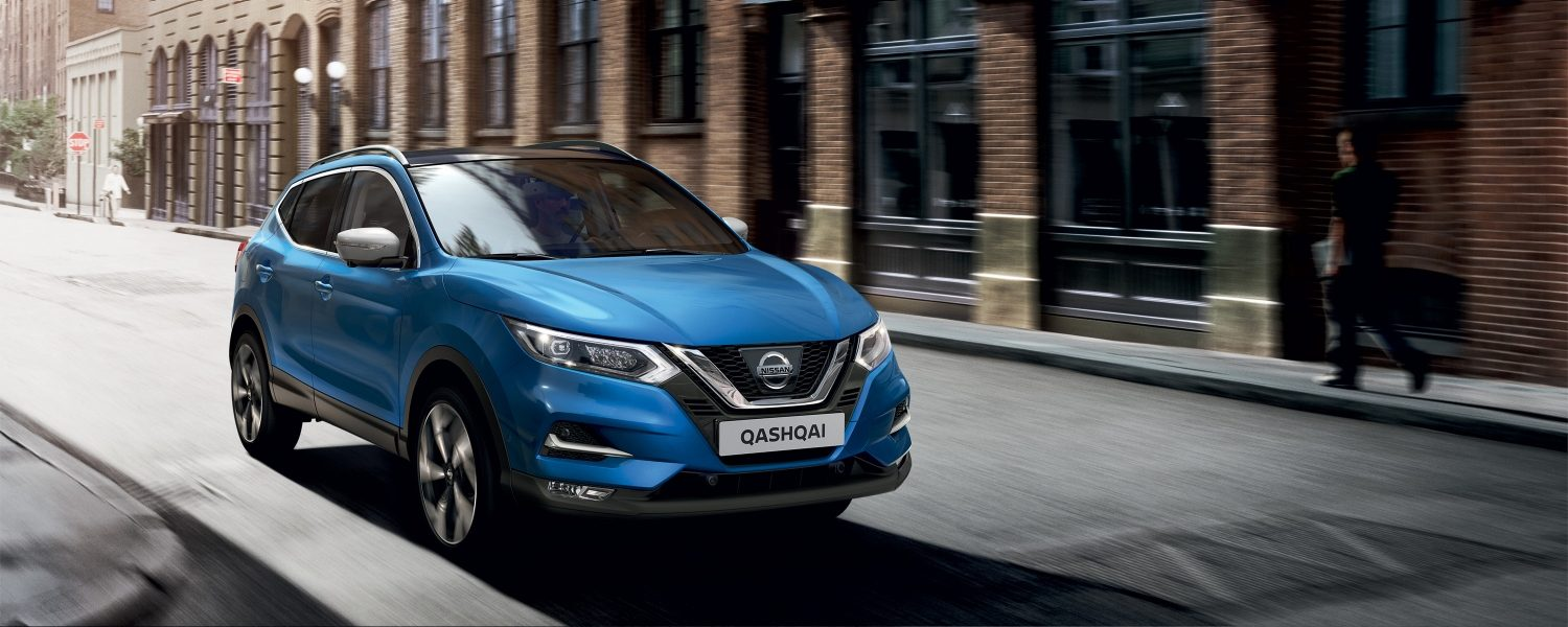 Nissan Qashqai driving in the streets 3/4 front view