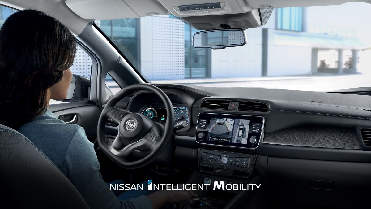 Nissan LEAF interior with a woman driving