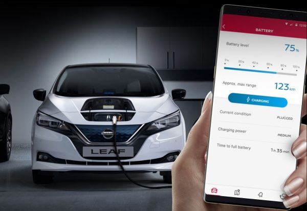 Nissan Leaf full front charging with smartphone showing battery screen in NissanConnect app