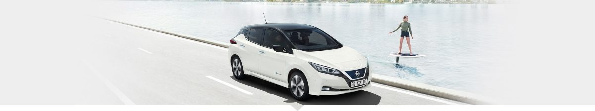 Nissan LEAF driving along a lake