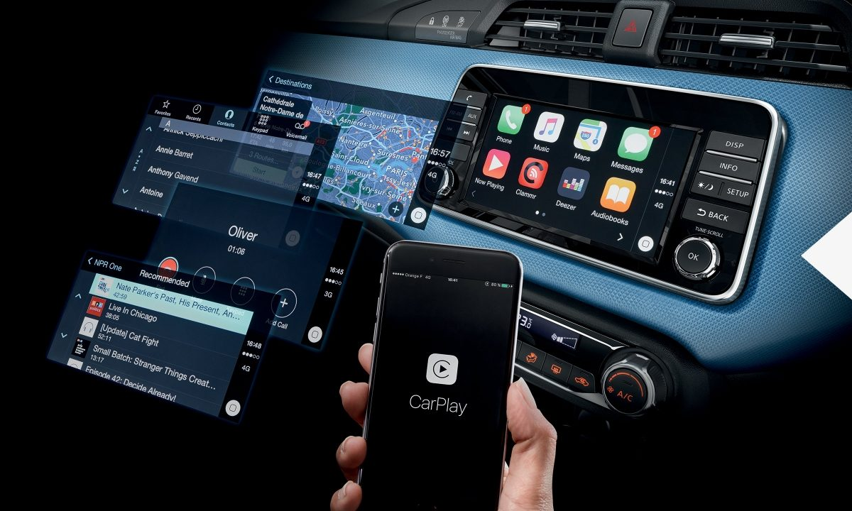 Nissan Micra interior with floating screens and smartphone with Apple CarPlay