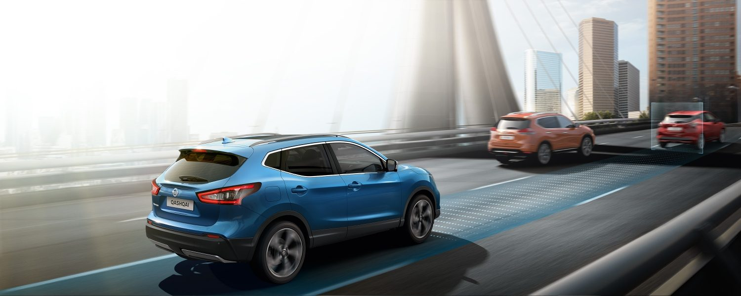 Nissan Qashqai rear view driving on a bridge