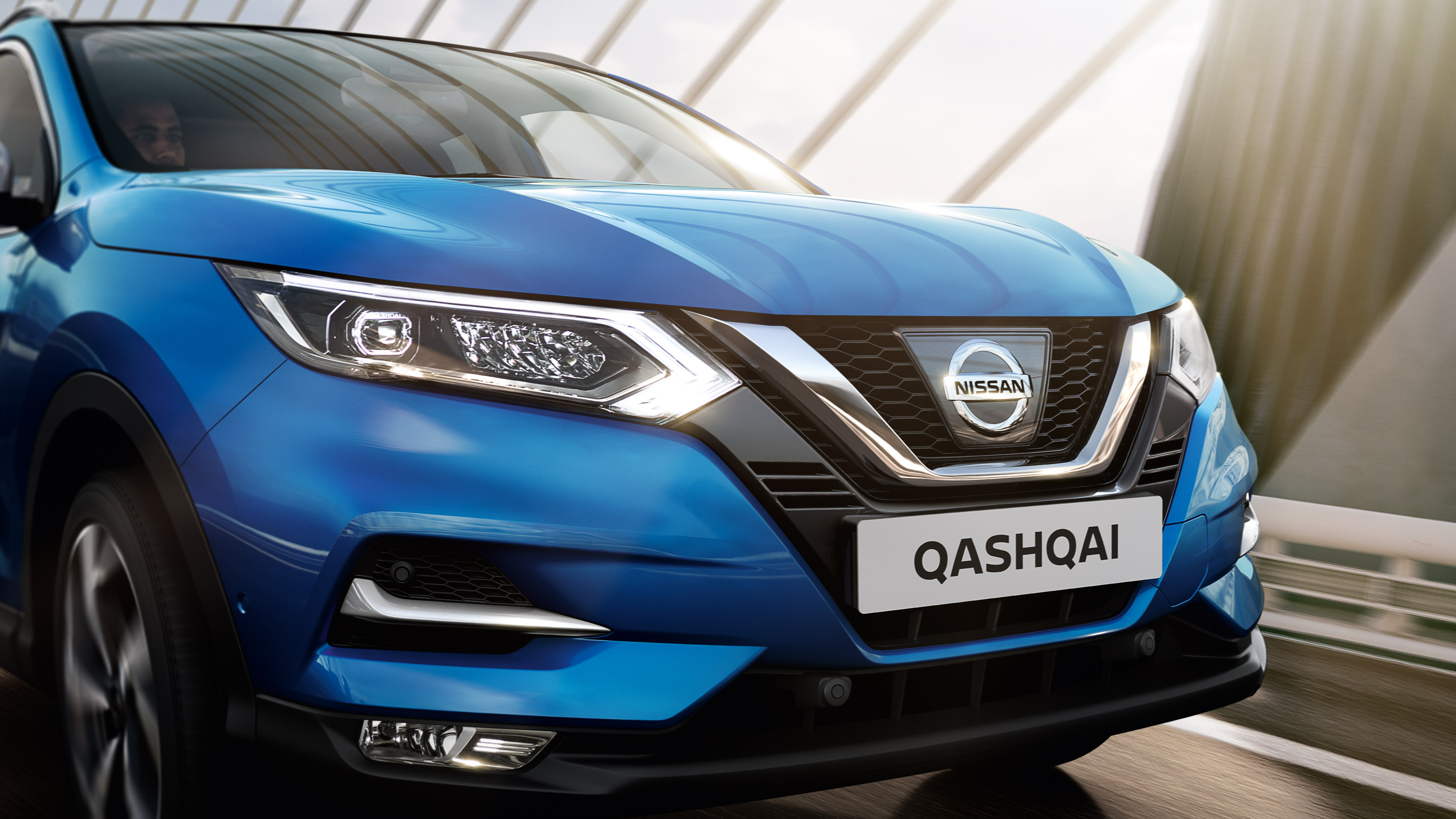 Nissan Qashqai front view driving on a bridge