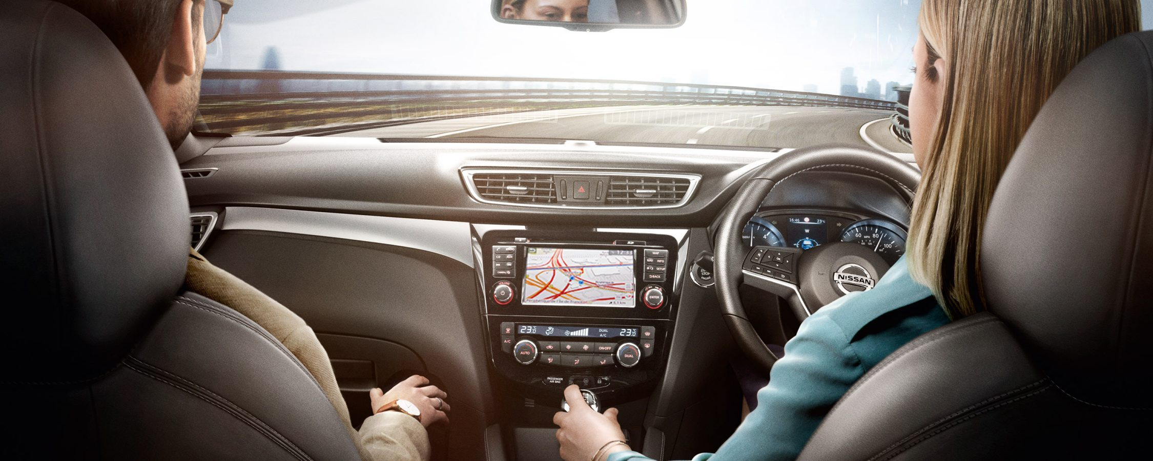 Nissan Qashqai interior view of the dashboard with people