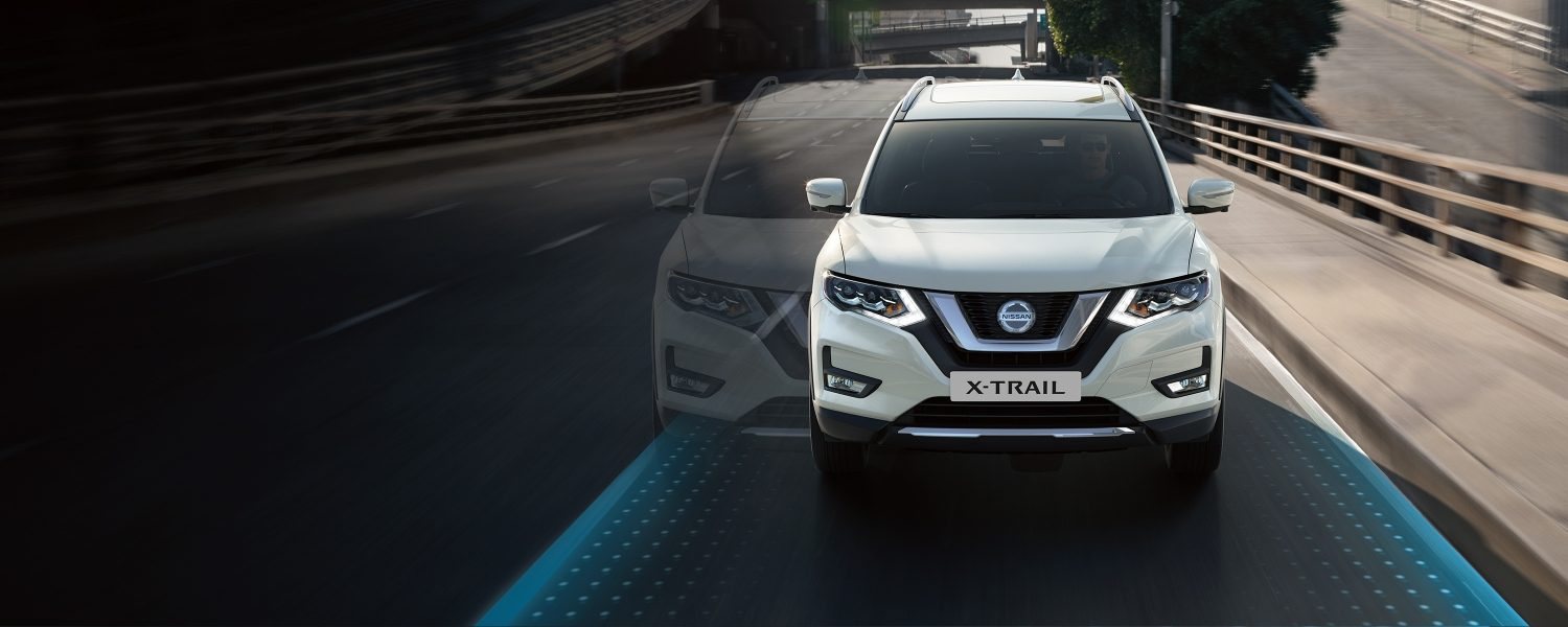 Nissan X-Trail front view driving with Nissan Intelligent Mobility graphics