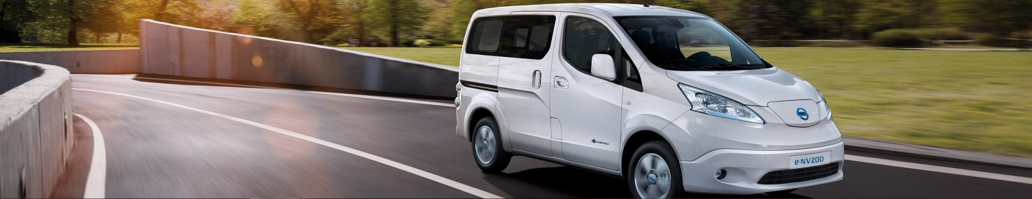 New Nissan e-NV200 Evalia driving shot in cith