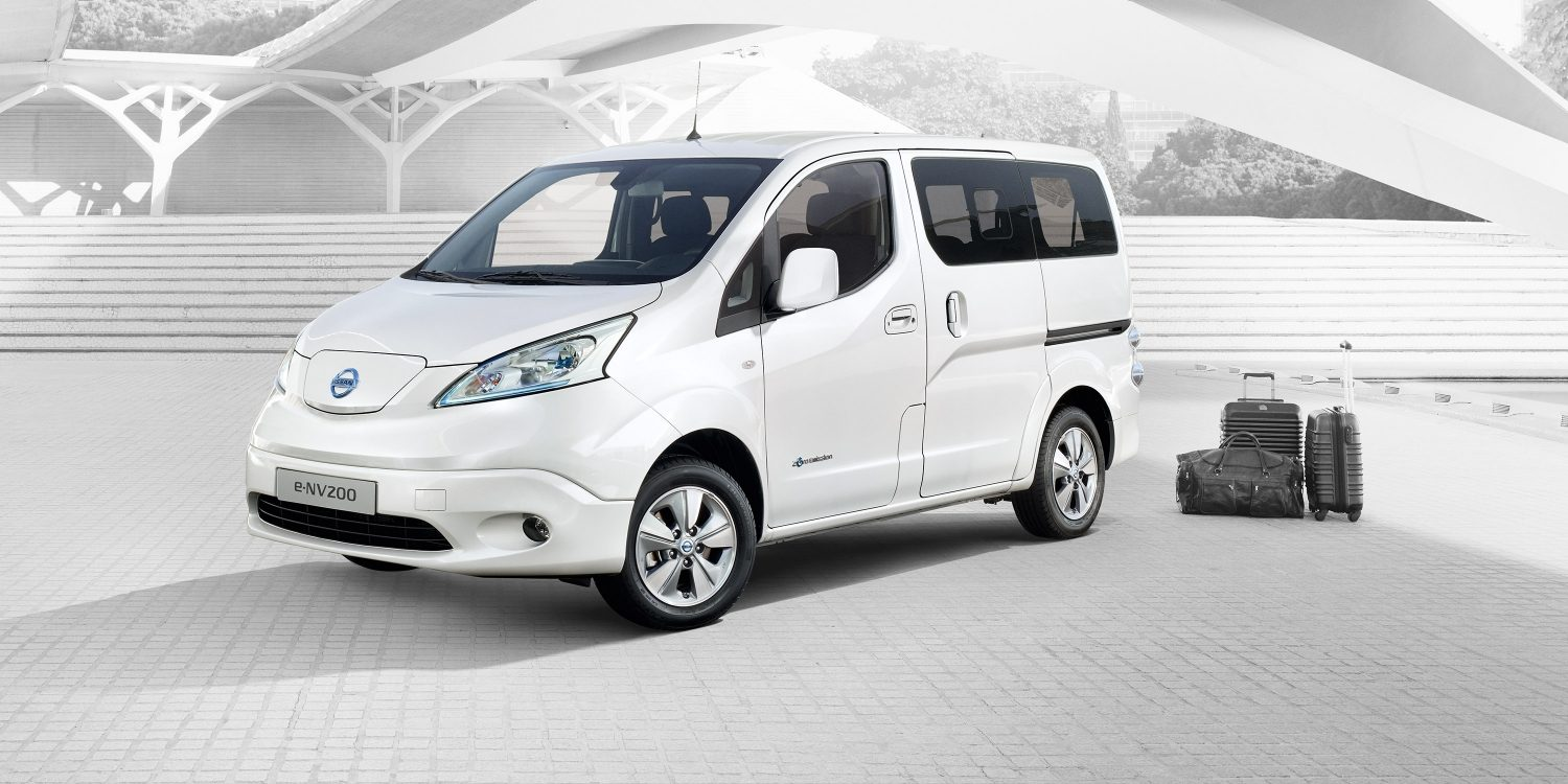 New Nissan e-NV200 Evalia 3/4 front in the street with luggage besides