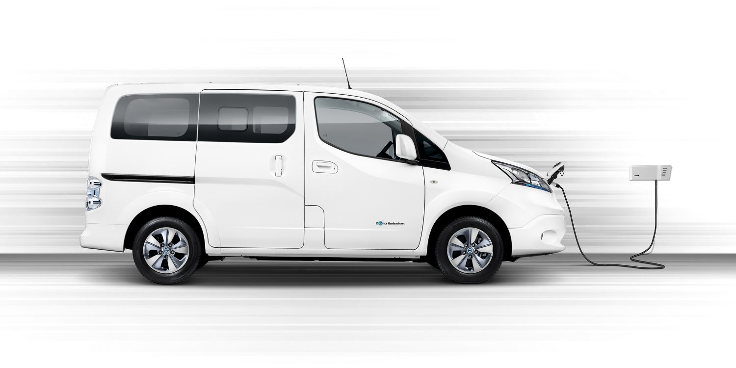New Nissan e-NV200 Evalia profile view charging on a wallbox