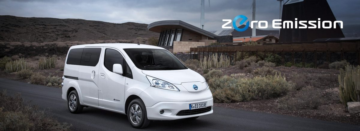 New Nissan e-NV200 Evalia parked close to wind turbines and zero emission logo
