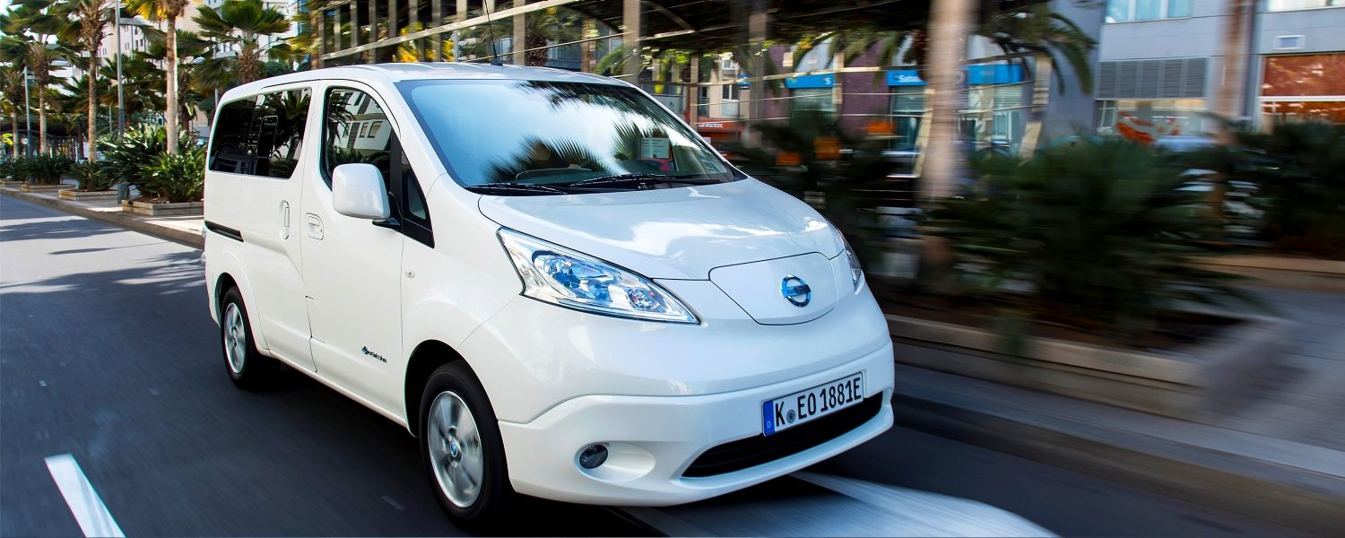 New Nissan e-NV200 Evalia close up driving shot in city