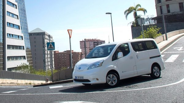 New Nissan e-NV200 driving in a city taking a corner