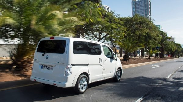 New Nissan e-NV200 Evalia 3/4 rear view driving in city