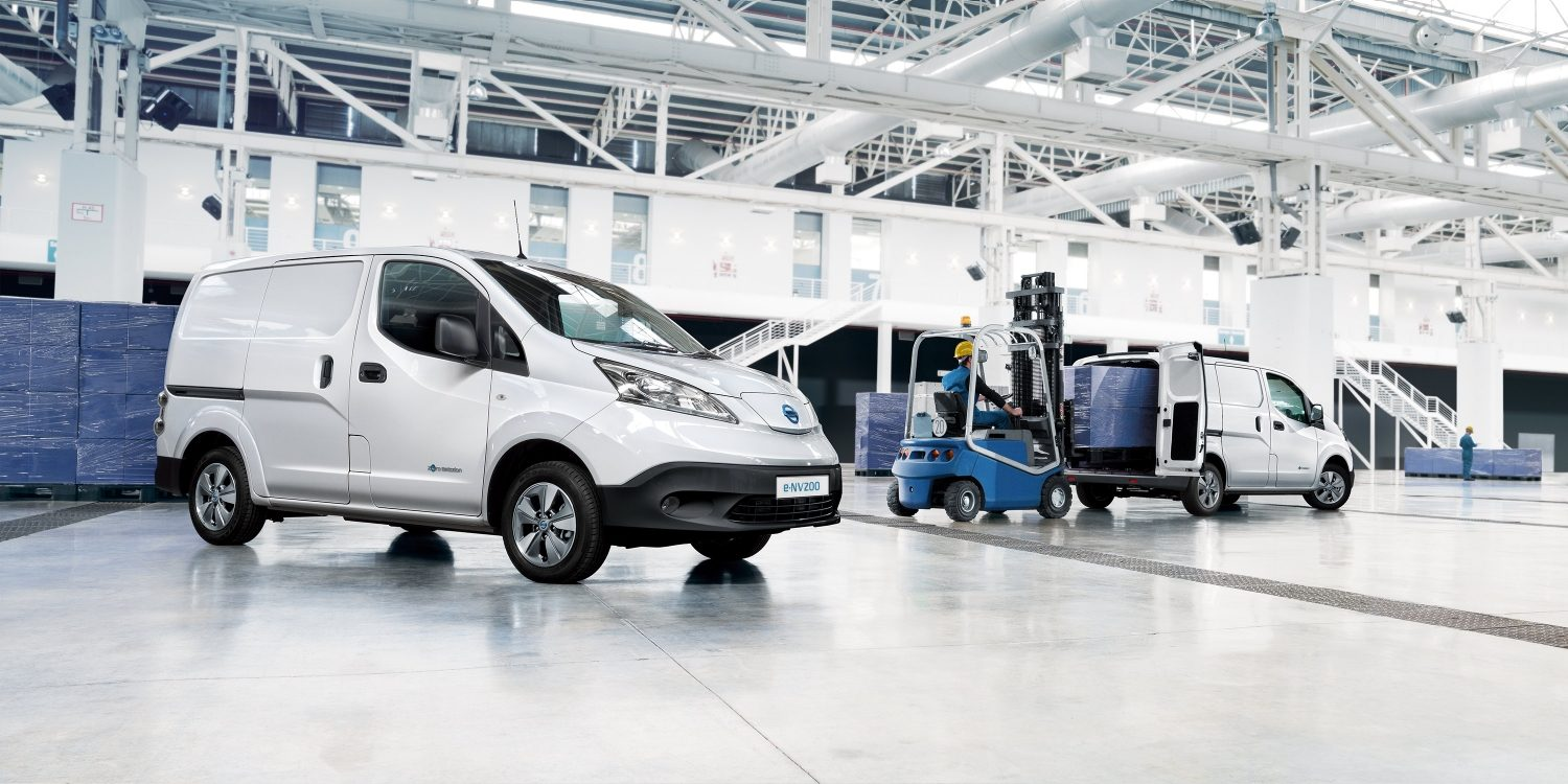 New Nissan e-NV200 image with one 3/4 front and one 3/4 rear with doors open and a pallet carrier loading the cargo with a euro pallet