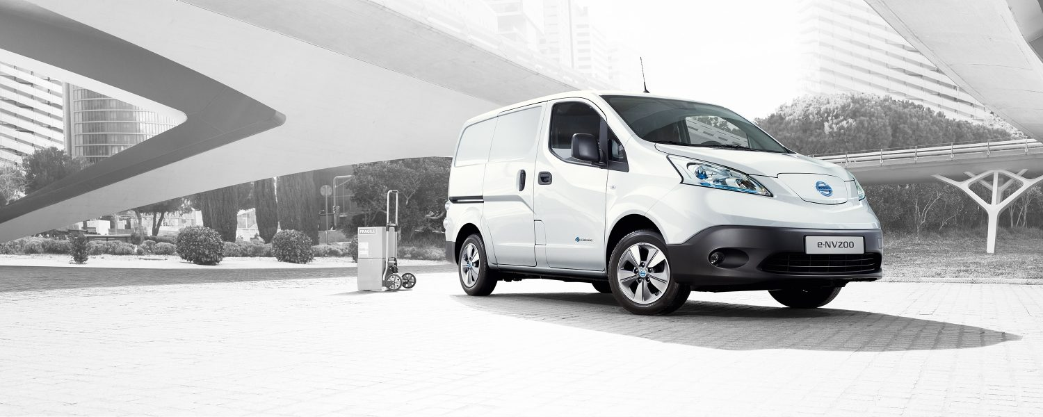 New Nissan e-NV200 parked in city with a hand trolley behind
