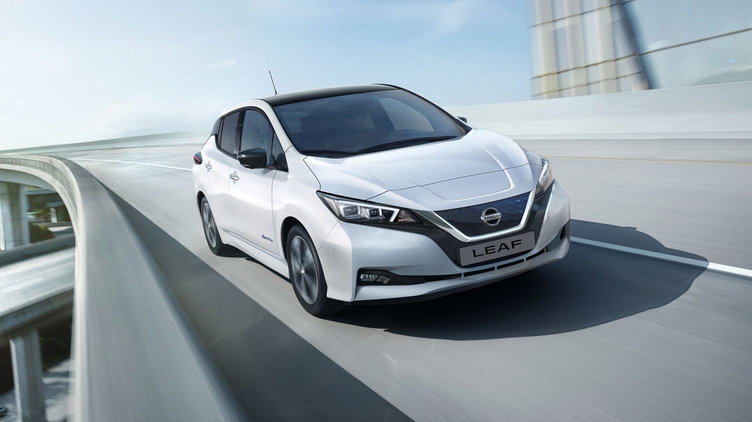 New Nissan LEAF driving shot on a bridge