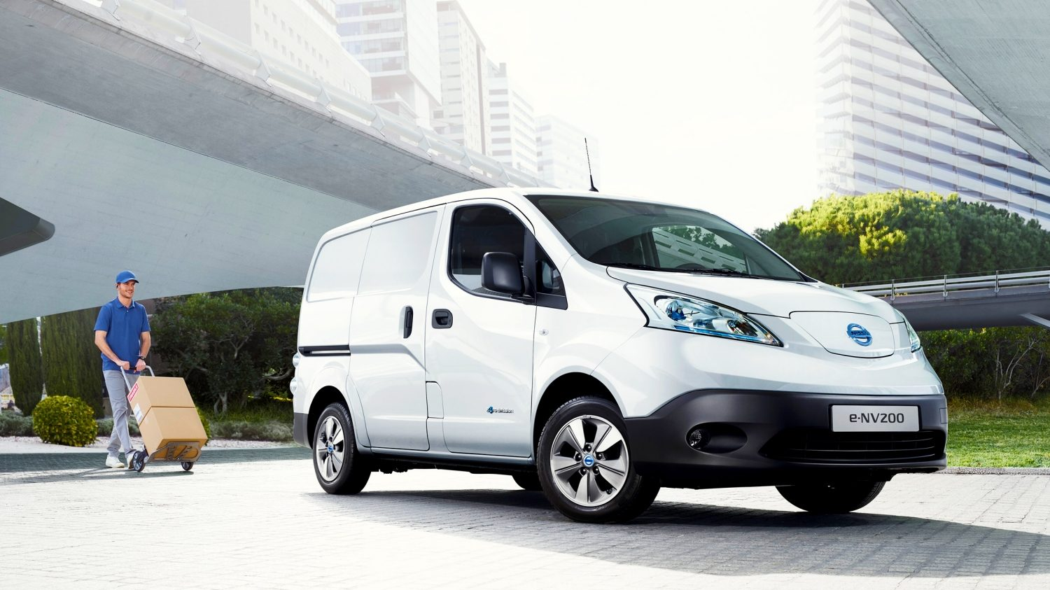 New Nissan e-NV200 3/4 front with a man going to the car with a hand trolley
