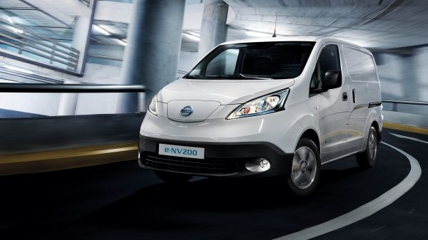 New Nissan e-NV200 driving shot in a parking lot