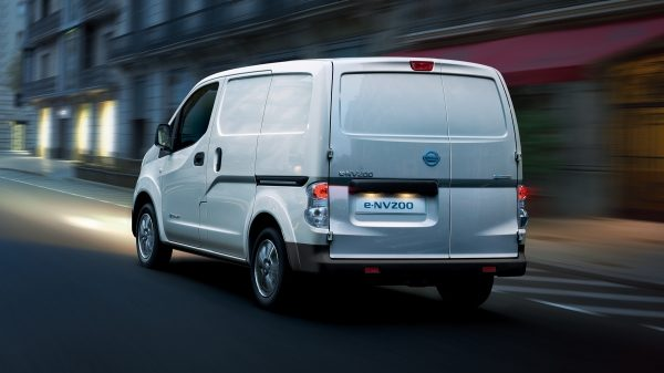 New Nissan e-NV200 driving shot in city at night