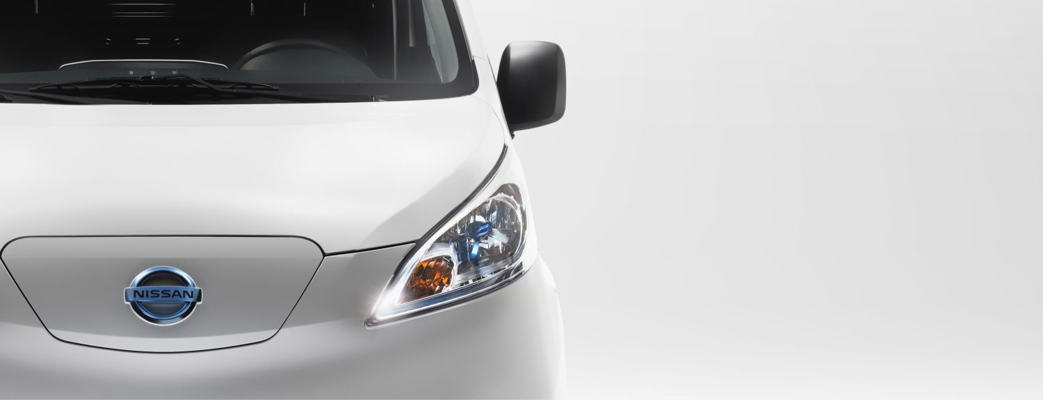 Nissan e-NV200 XL focus on the front view (Nissan logo & headlamp)