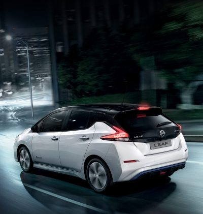 Nissan LEAF driving in city by night