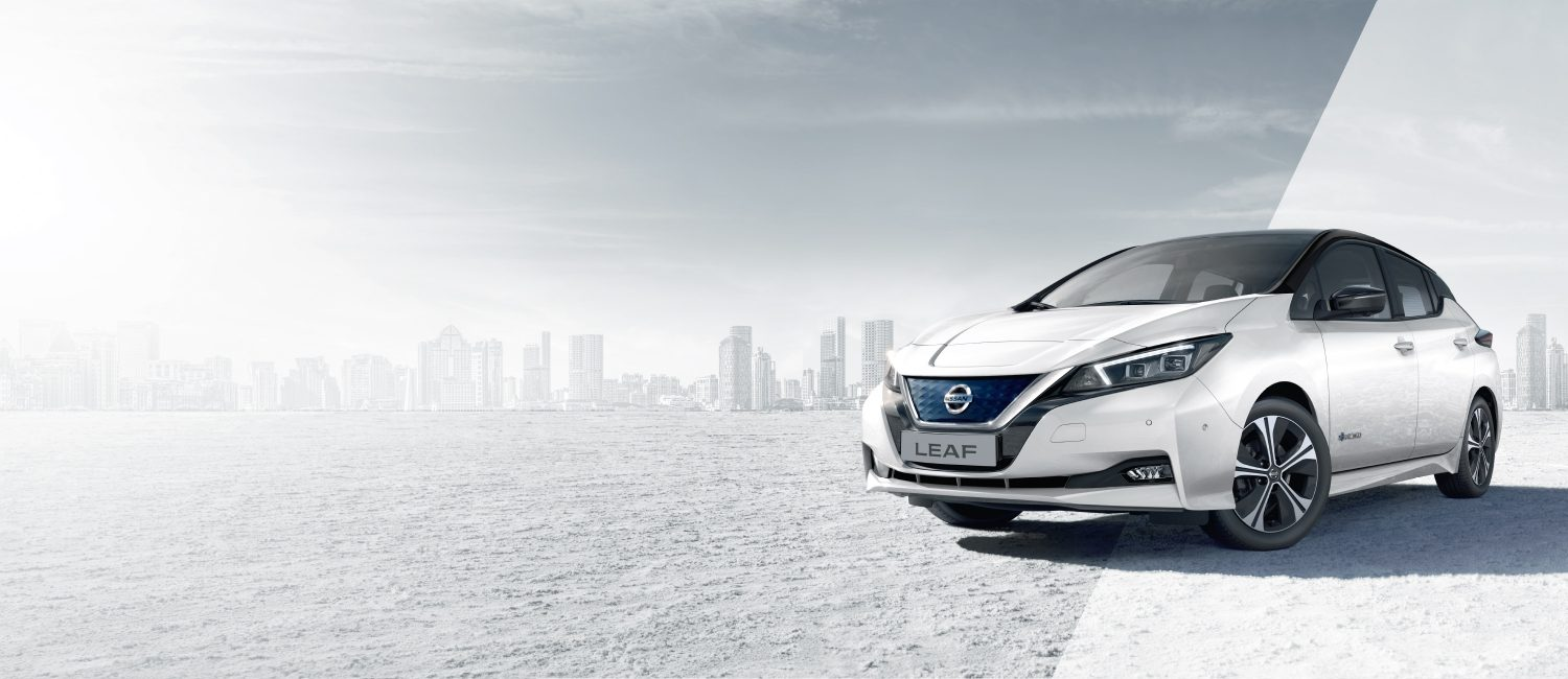 official photos 5284c b0927 Nissan LEAF 3 4 front with city in the background