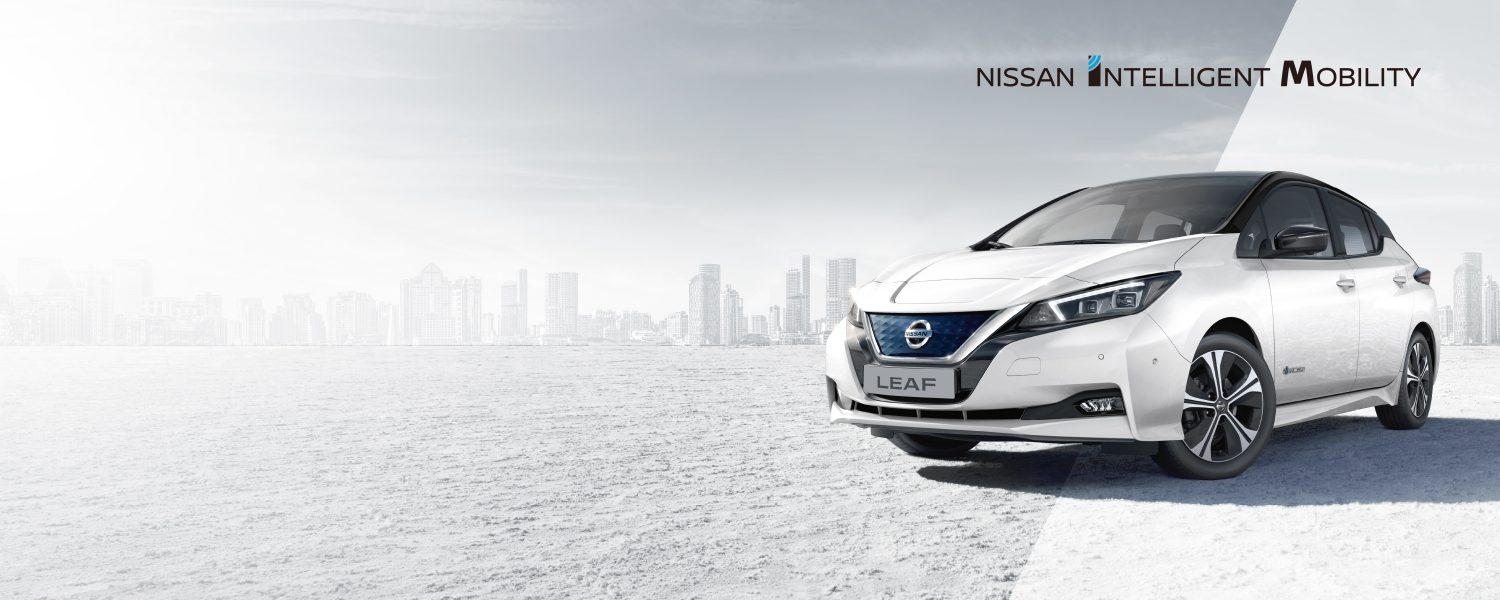 Nissan LEAF 3/4 front with city in the background
