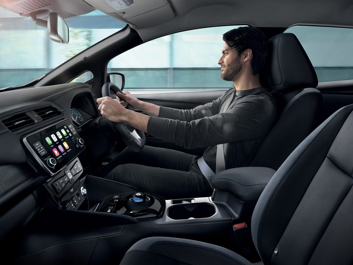 Profile interior view of a man driving a Nissan LEAF