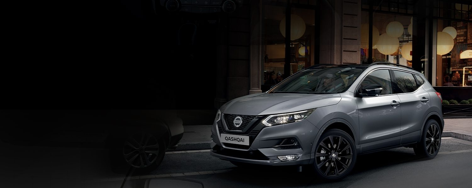 Nissan QASHQAI N-TEC parking on the street